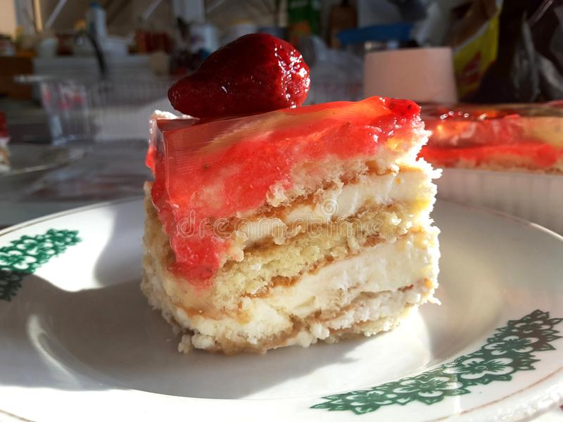 A piece of strawberry cake with fruit jelly royalty free stock photography