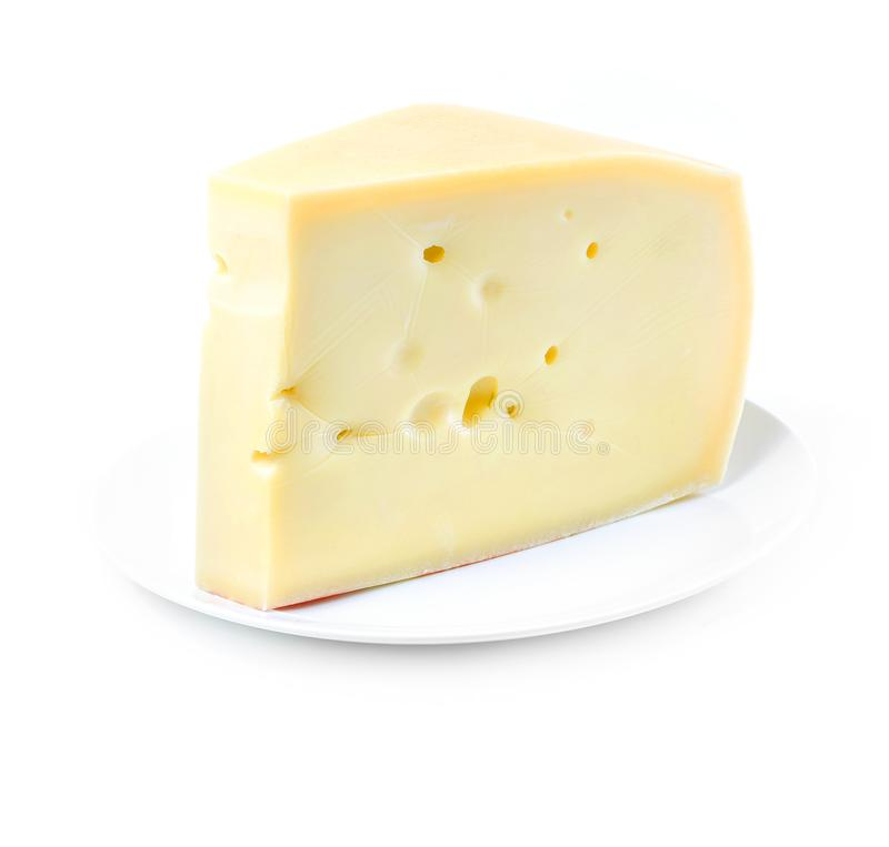 Piece of Swiss cheese on white plate on white background stock image
