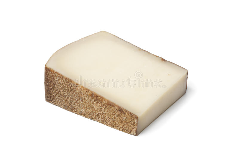 Piece of Swiss Gruyere cheese. On white background royalty free stock image