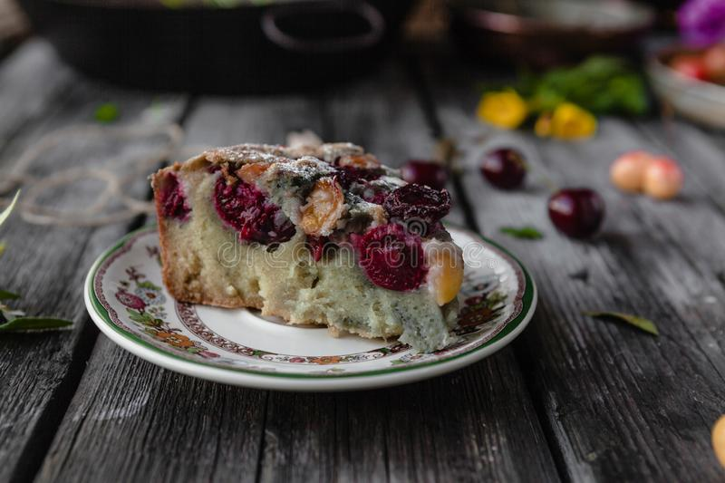 piece of tasty cake with berries and fruits on plate stock photos