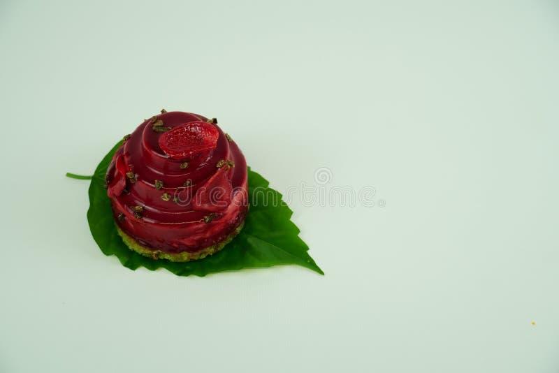 Piece of tasty cranberry cake on white background royalty free stock photos