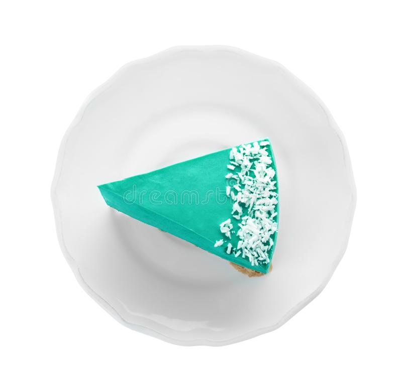 Piece of tasty spirulina cheesecake on background, top view stock images