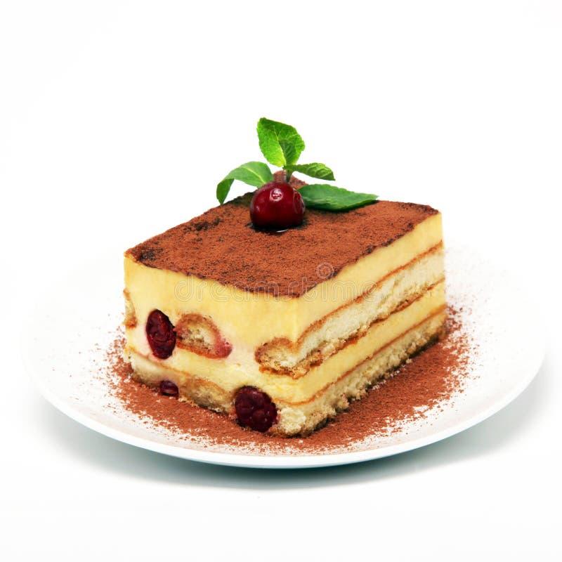 Piece of tiramisu cake on white plate stock image