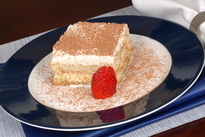 Download A Piece Of Tiramisu Dusted With Cocoa On A Blue Plate Stock Photo - Image: 1773320