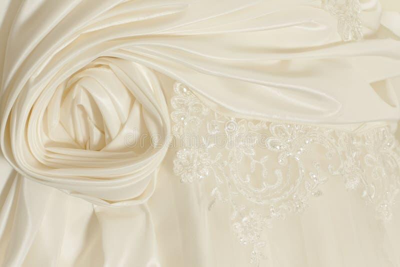 Piece wedding dress. Of cream silk fabric stock photography