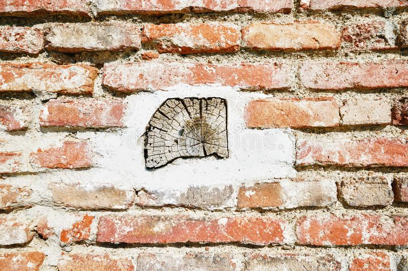 Piece of wood in brick wall royalty free stock photo