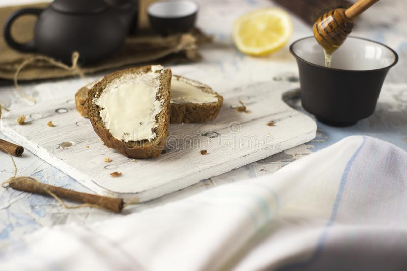 Pieces of bread with butter and honey royalty free stock photo