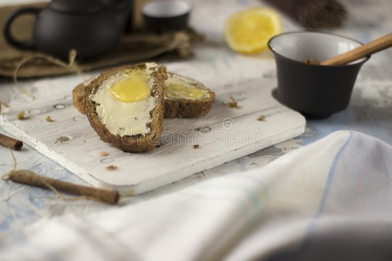 Pieces of bread with butter and honey royalty free stock photography