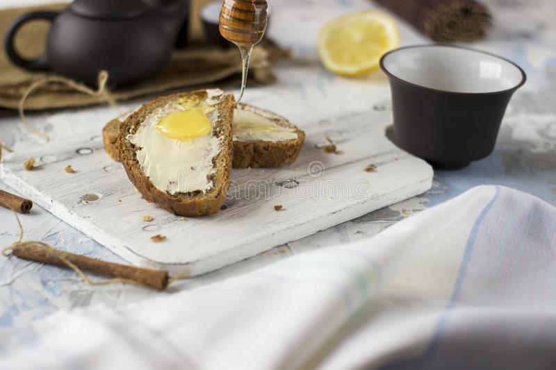 Pieces of bread with butter and honey stock photo