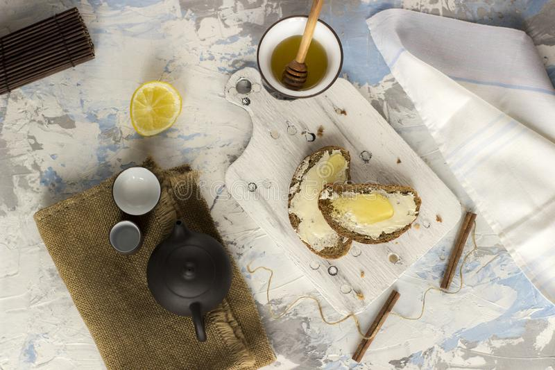 Pieces of bread with butter and honey, view from above stock photography