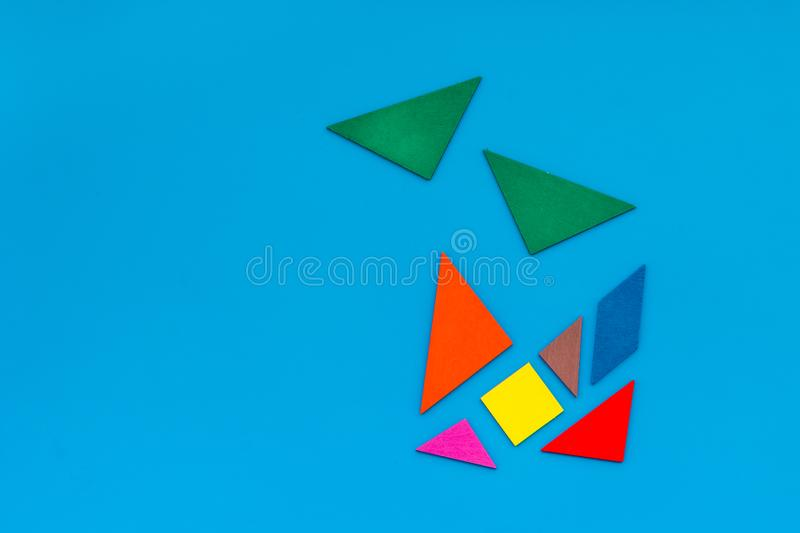 Pieces of bright paper for puzzle on blue office background top view mockup royalty free stock photography