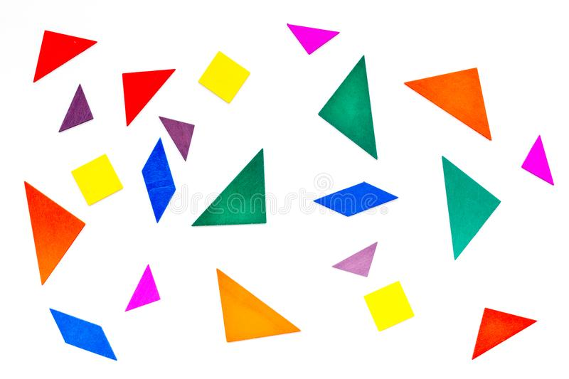 Pieces of bright paper for puzzle on white office background top view pattern royalty free stock photos