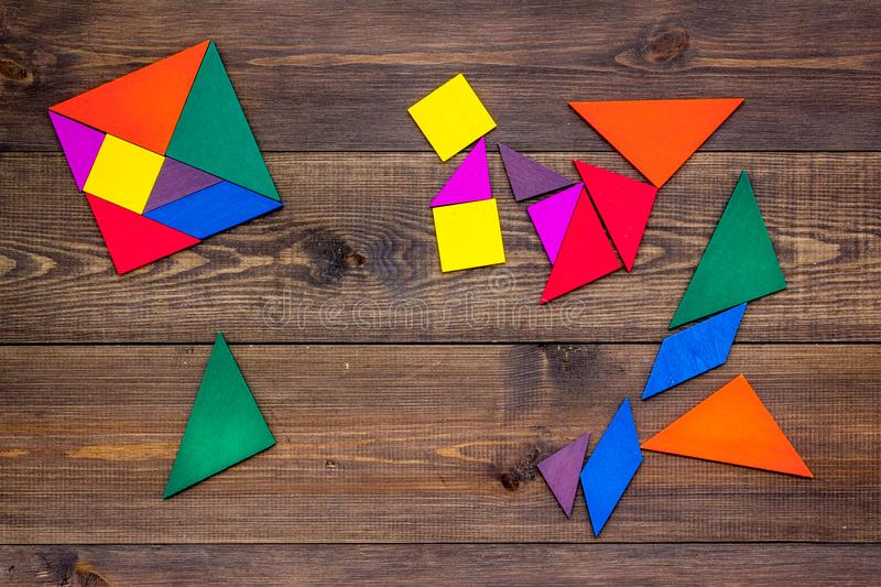 Pieces of bright paper for puzzle on wooden office background top view mockup royalty free stock image