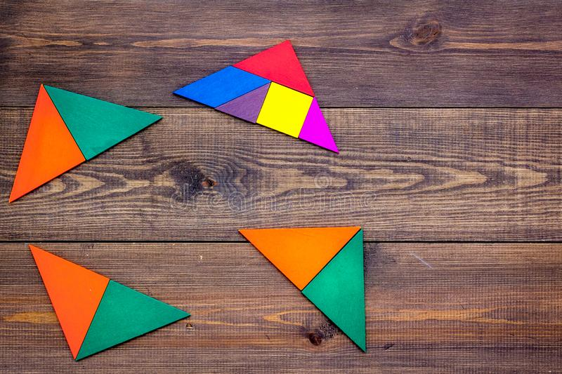 Pieces of bright paper for puzzle on wooden office background top view mockup stock photography