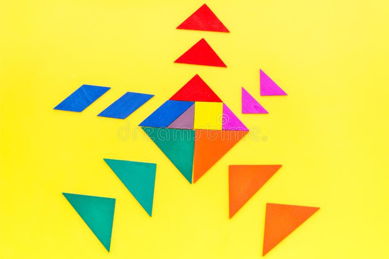 Pieces of bright paper for puzzle on yellow office background top view mockup royalty free stock photography
