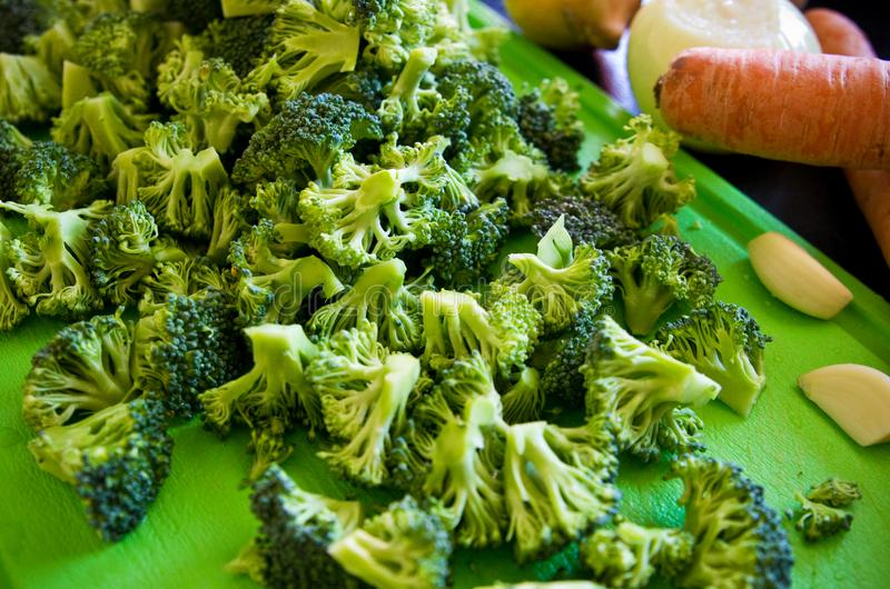 Pieces of broccoli on cutting board royalty free stock photo