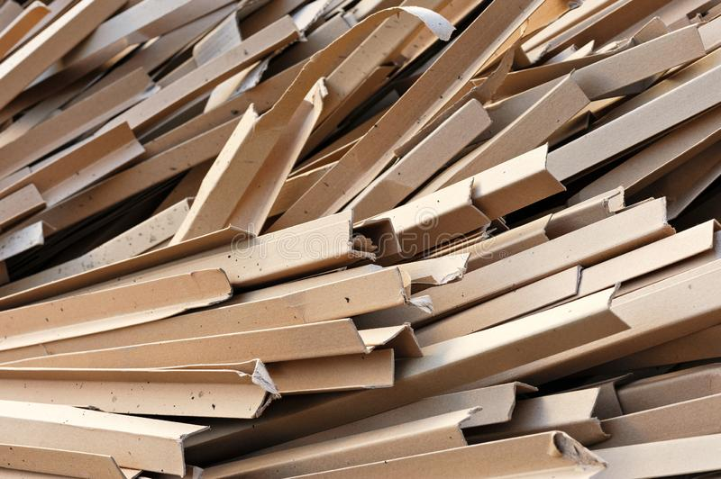 Piles of cardboard boxes stored for recycling. Pieces Of Cardboard Boxes On The Recycling Plant. Close-Up Of Cardboard Leftover. Separating Garbage For Disposal royalty free stock images