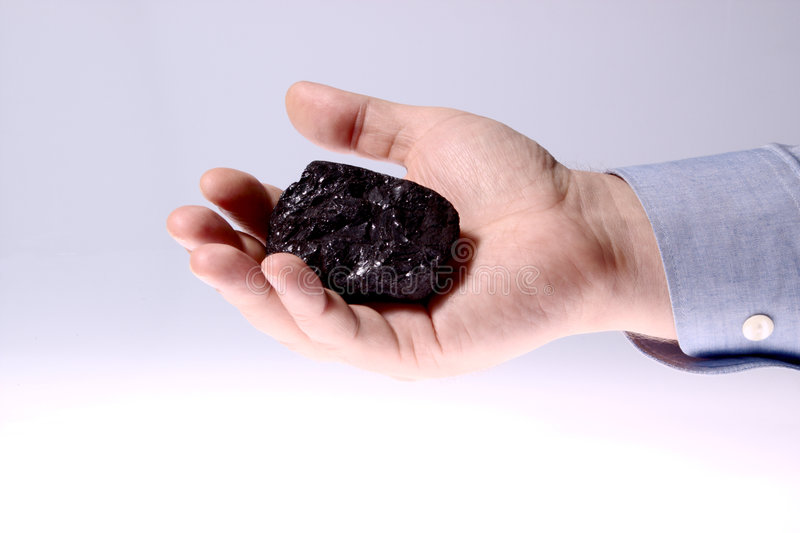 Download Pieces Of Coal In Palm/ Holding Coal Stock Photo - Image: 4571320