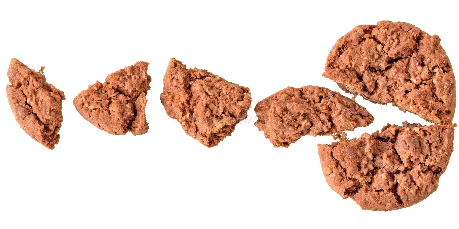 Pieces of crumbly cookies. With cereals and chocolate top view isolated on white background royalty free stock photo