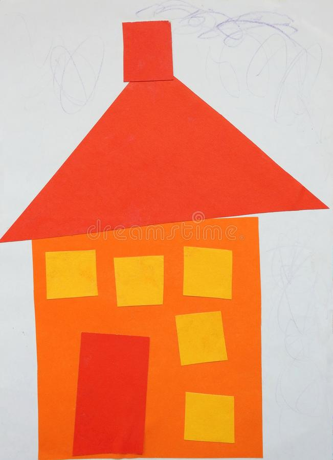 Pieces cut from paper and do home. Children cut paper pieces and do beautiful home royalty free stock images