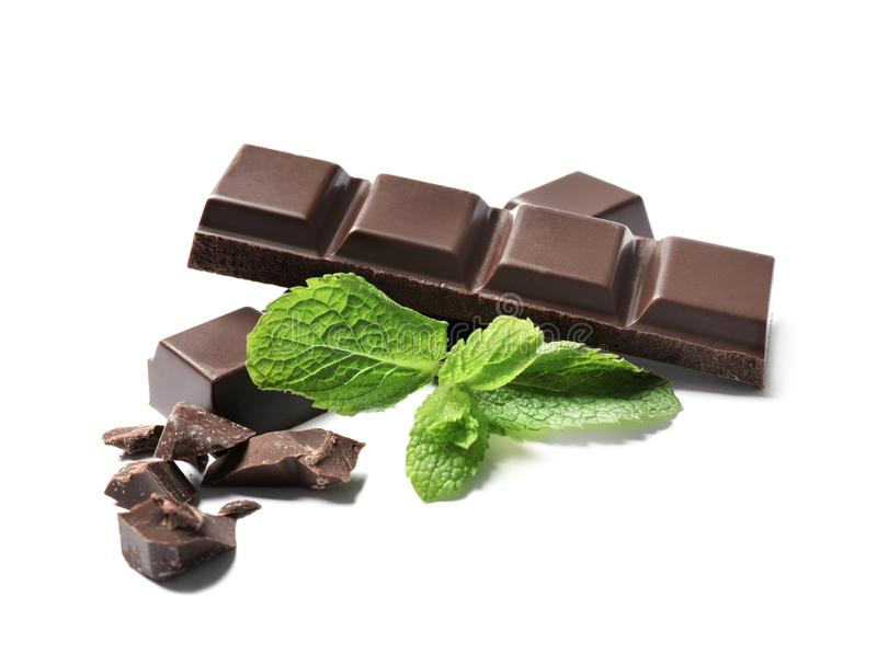 Pieces of dark chocolate with mint. On white background stock image