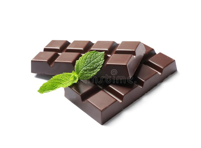 Pieces of dark chocolate with mint. On white background stock photography