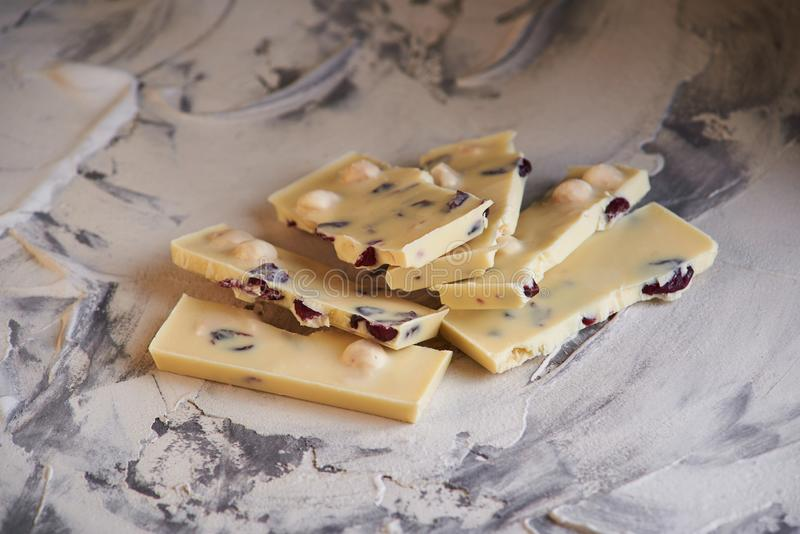 Pieces of dark and white chokolate on gray background royalty free stock photo