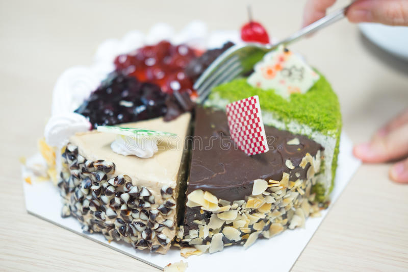 Pieces of different cakes. Eating royalty free stock photos