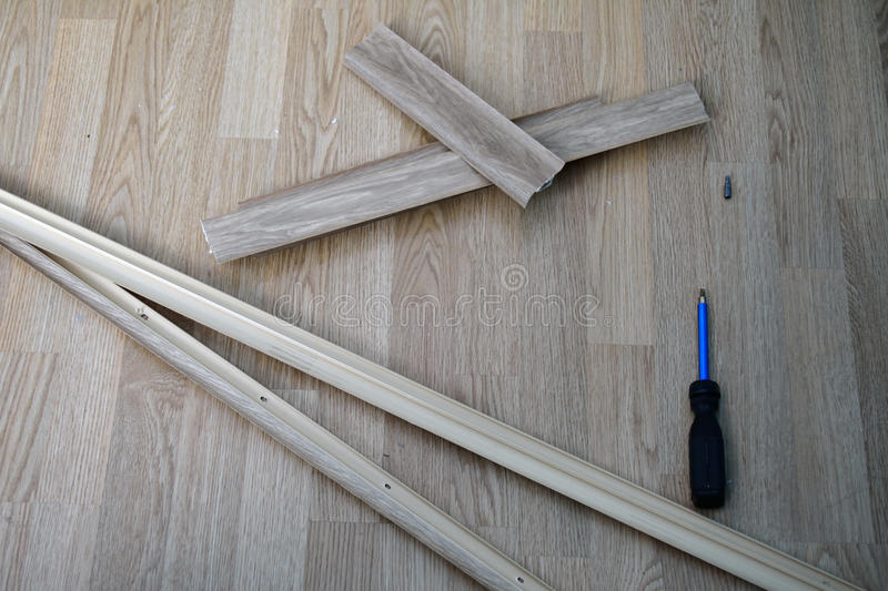 Pieces of dismantled baseboard. Lying on the floor stock photos