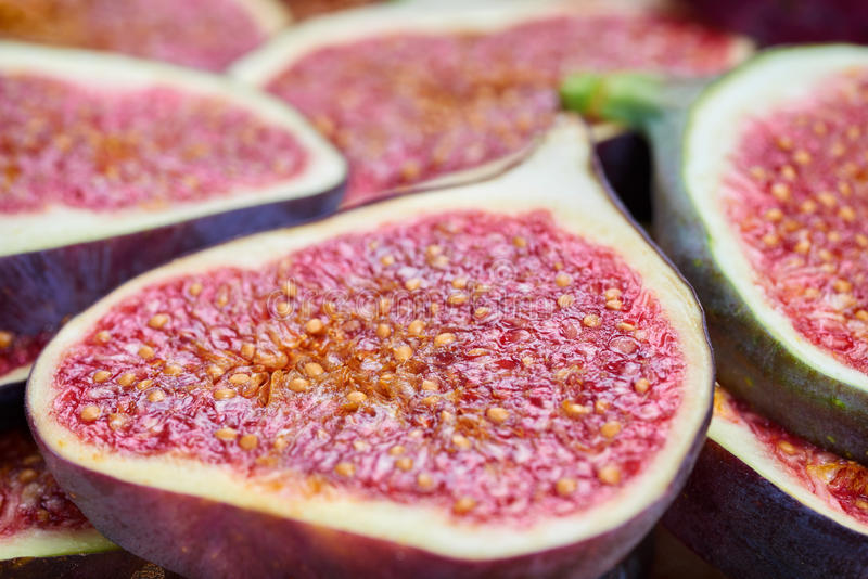 Pieces of fig on a stone board. Fruit background royalty free stock photo