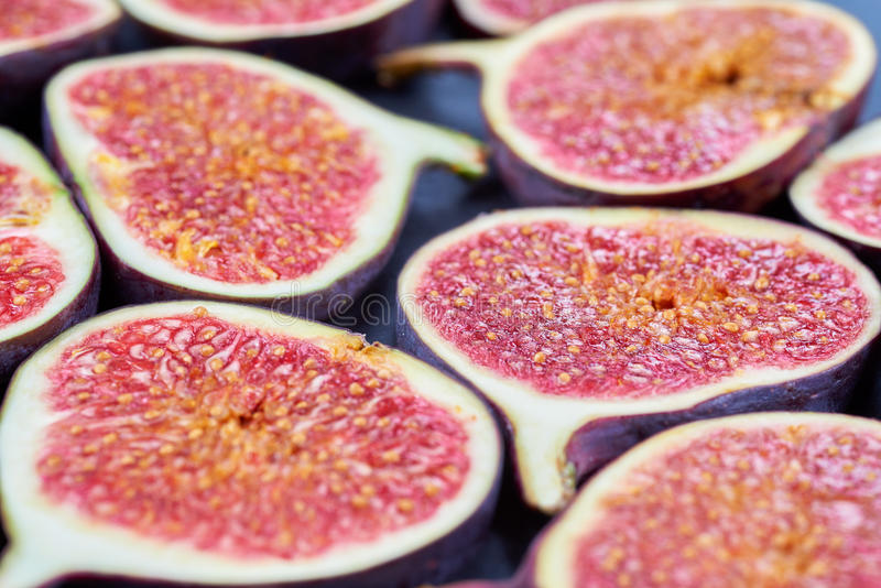 Pieces of fig on a stone board. Fruit background royalty free stock photos
