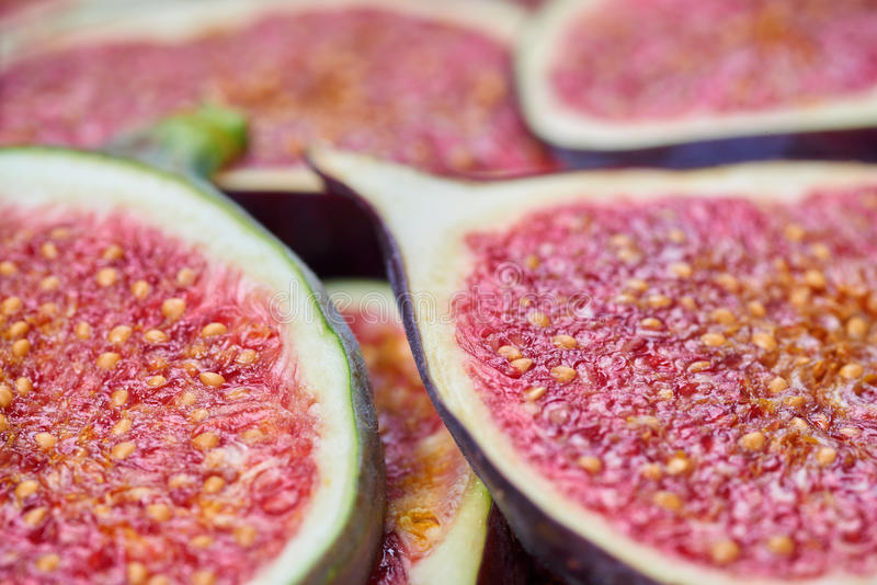 Pieces of fig on a stone board. Fruit background stock image