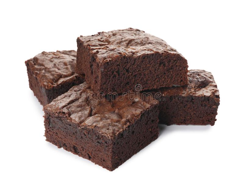 Pieces of fresh brownie on white. Delicious chocolate pie royalty free stock image