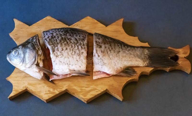 Pieces of fresh fish on a board royalty free stock photo