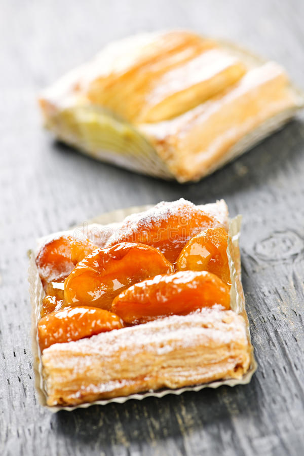 Pieces of fruit strudel. Closeup on two slices of flaky fruit strudel desserts stock images