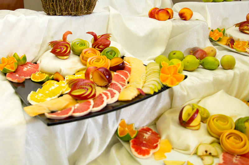 Pieces of fruit, swans from fruit stock images