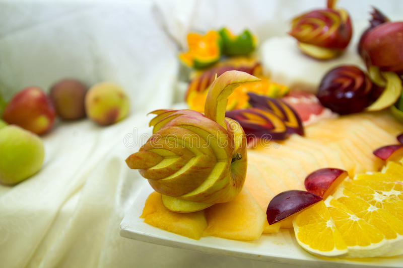 Pieces of fruit, swans from fruit royalty free stock photo
