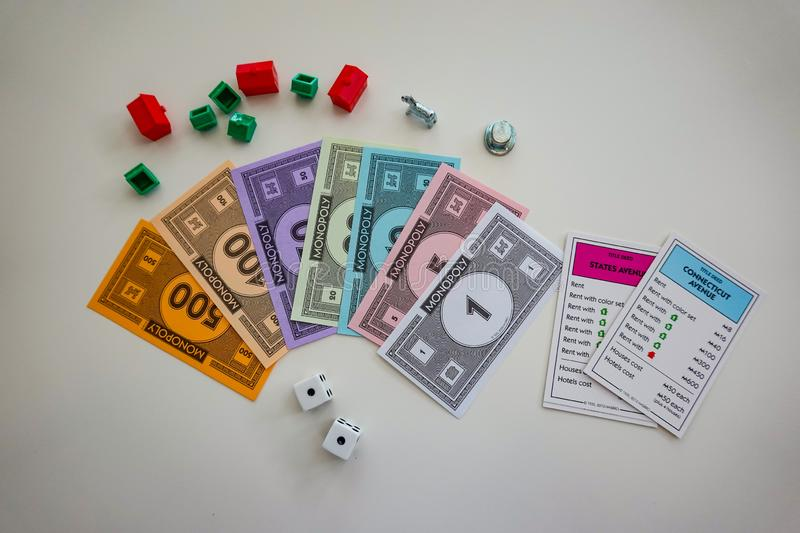 Pieces for the game Monopoly by Hasbro. Orlando,FL/USA-8/29/19: Pieces for the game Monopoly by Hasbro on a white background royalty free stock images