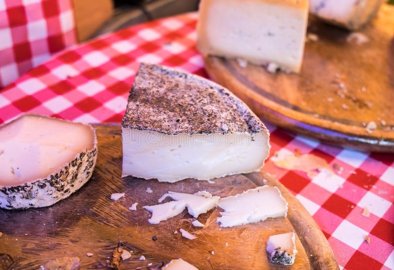 Pieces of Goat cheese for sale. At local street market stock photo