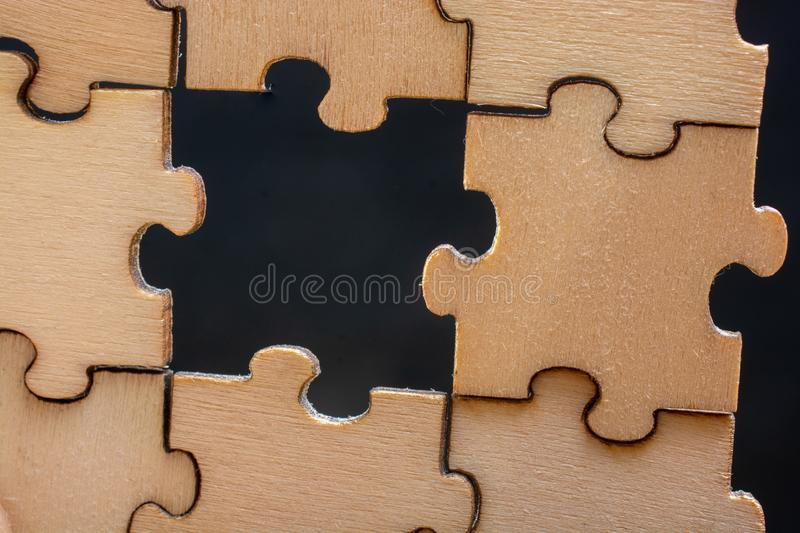 Pieces of jigsaw puzzle  as business strategy concept. Piece of jigsaw puzzle as business strategy problem solving concept royalty free stock photo