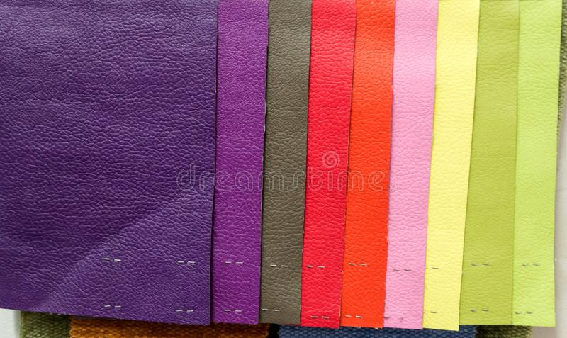 Pieces of leather material for example. In the catalog of different colors for the design studio royalty free stock images