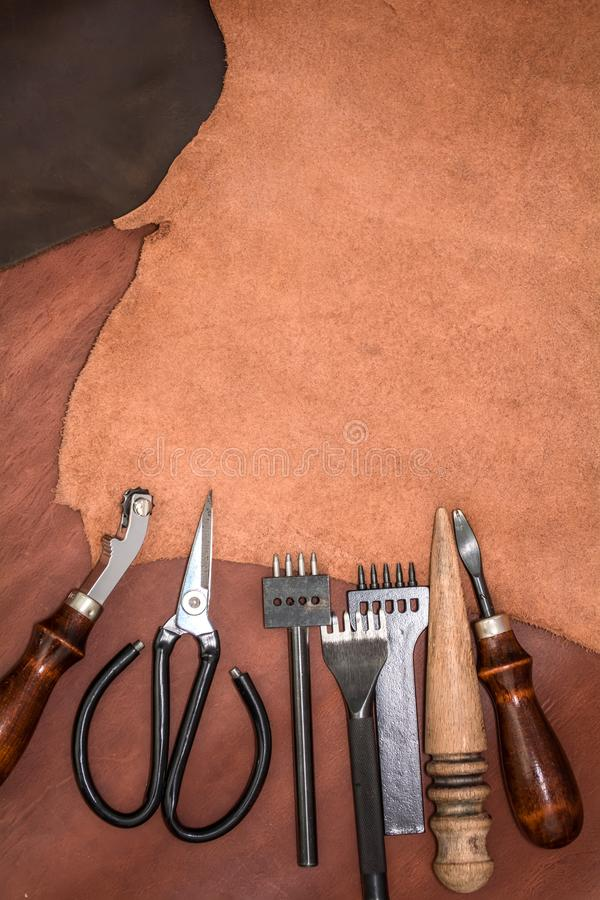 Pieces of leather and working tools. Craftman`s workspace.  royalty free stock photo
