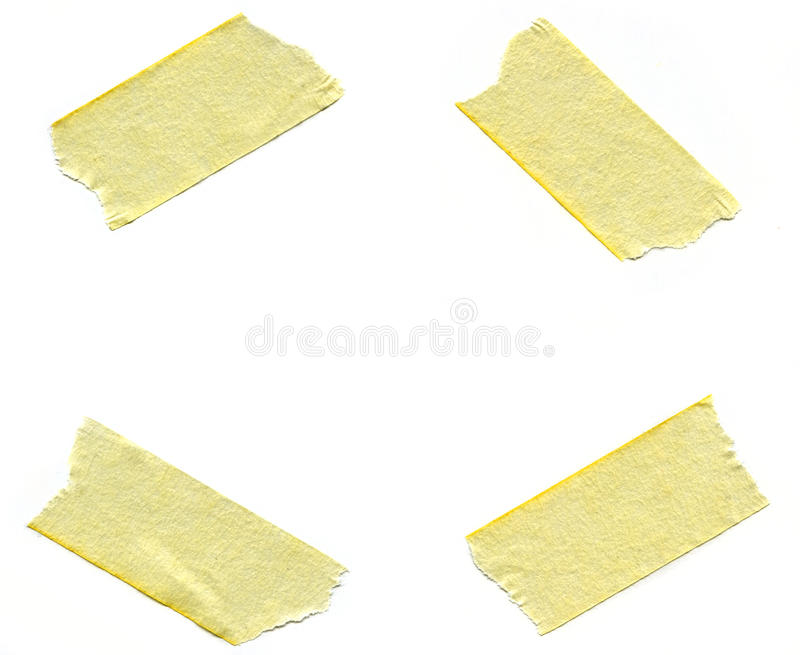 Pieces of Masking Tape. Four pieces of masking tape over white background royalty free stock photography