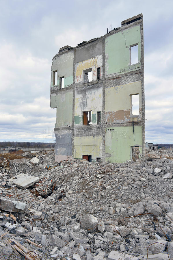 Pieces of Metal and Stone are Crumbling from Demolished Building Floors.  royalty free stock photography