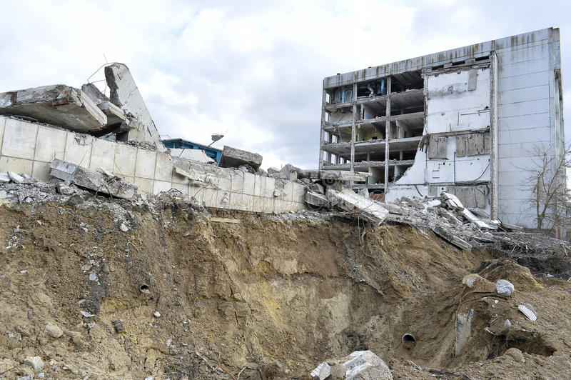 Pieces of Metal and Stone are Crumbling from Demolished Building Floors.  stock photography