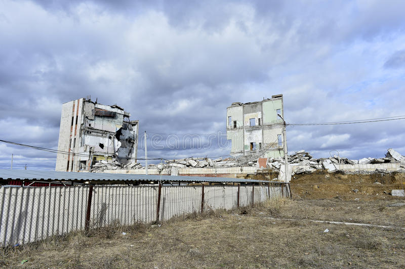 Pieces of Metal and Stone are Crumbling from Demolished Building Floors.  stock photos