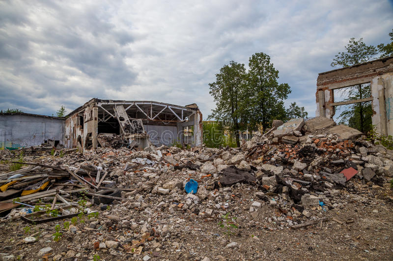 Pieces of Metal and Stone are Crumbling from Demolished. Pile of debris of a destroyed building. Pieces of Metal and Stone are Crumbling from Demolished stock photography