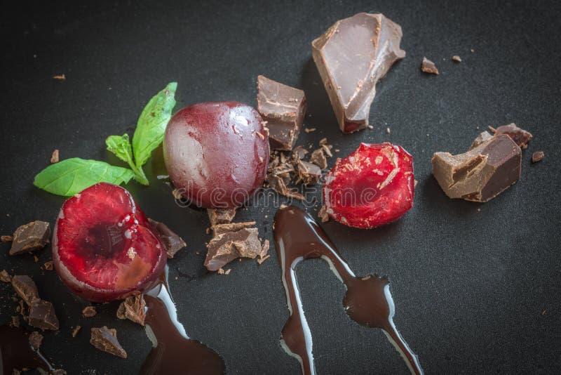Pieces of milk chocolate and cherries stock photo