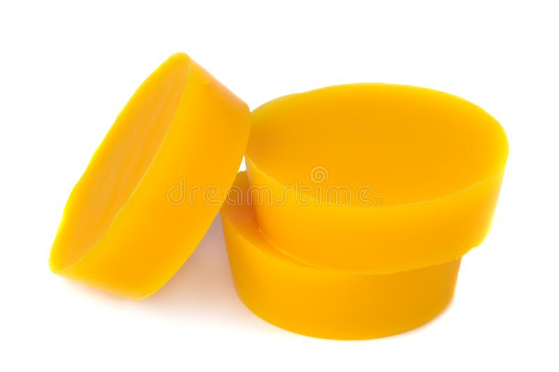Pieces of natural beeswax are isolated on a white background. Beekeeping products. Apitherapy. stock image