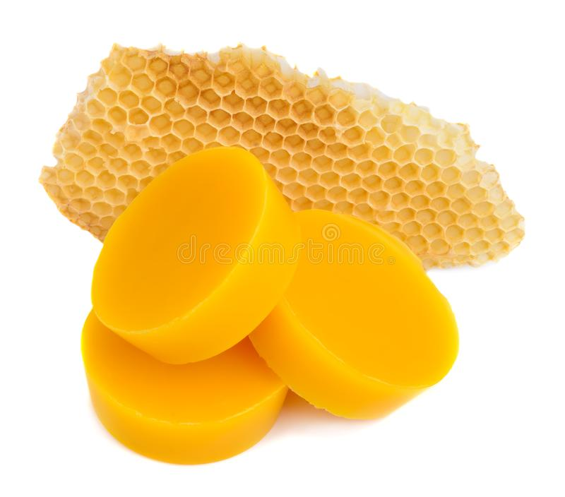 Pieces of natural beeswax and a piece of honey cell are isolated on a white background. Beekeeping products. Apitherapy. royalty free stock photography
